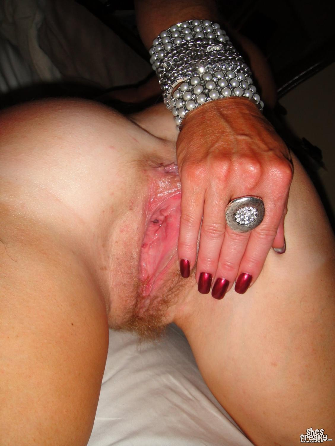 image Chubby milf cums on the phone at work