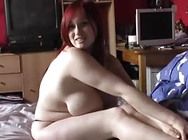 Busty redhead playing