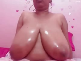 Big Oiled Tit Dominican GILF