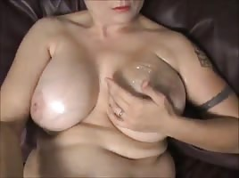 Oiling down big white boobs