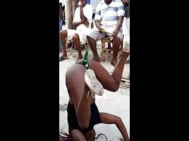 Jamaica girl plays wit bottle