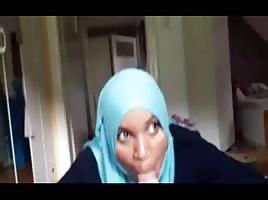 Black babe in hajib gives blowjob