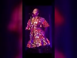 SINGER JILL SCOTT  SHOWING HOW HER HEAD GAME IS.