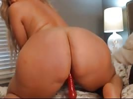 Busty babe with sexy body curves fucks herself with toy