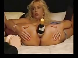 Amateur - pierced big naturals rides a big bottle